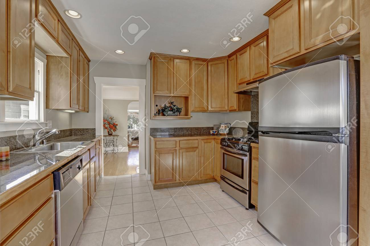 Nicely Updated Kitchen With Lots Of Storage Cabinets Grey Brown Stock Photo Picture And Royalty Free Image Image 100377619