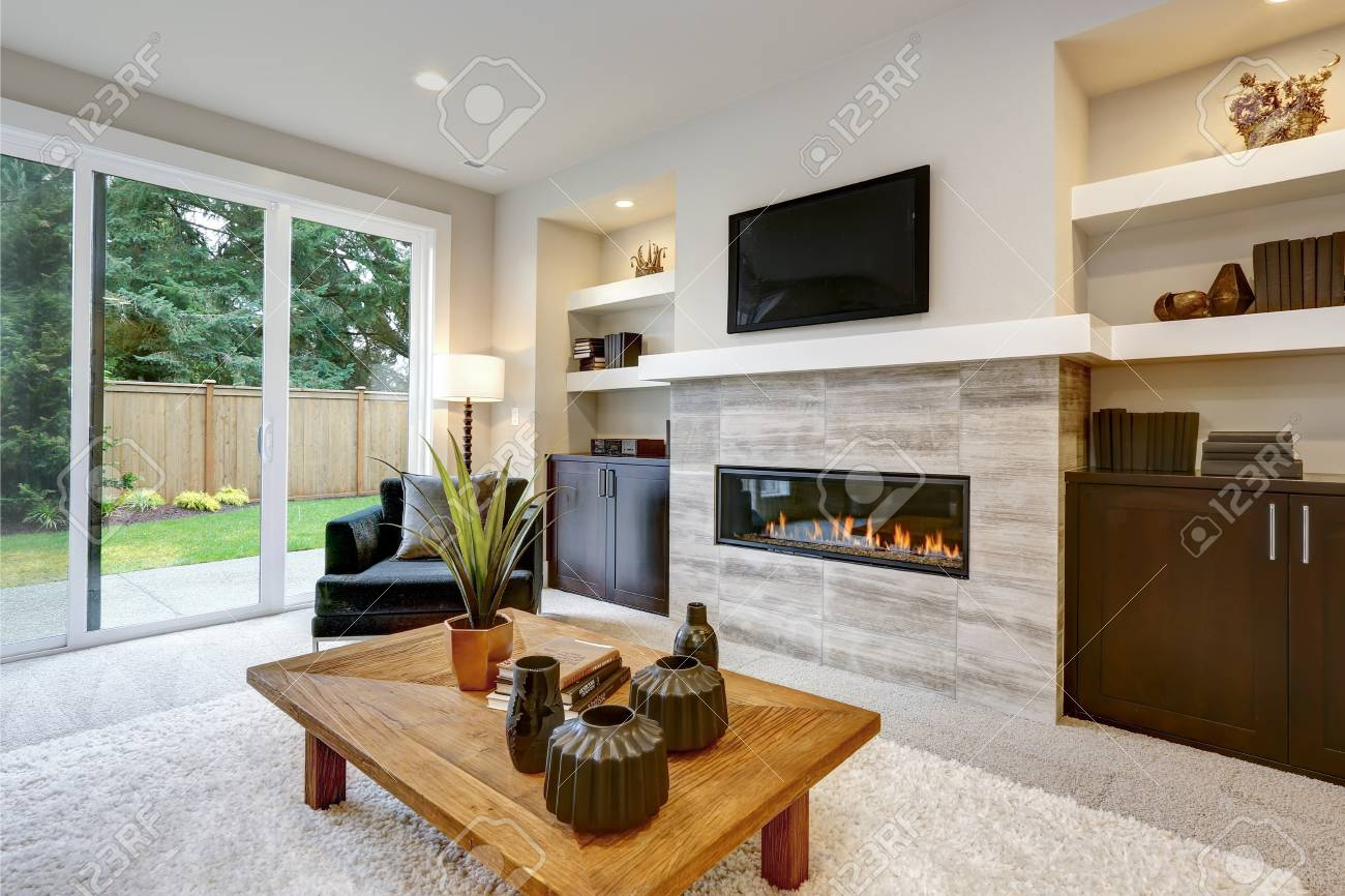Beautiful Modern Living Room Interior With Stone Wall And Fireplace ...