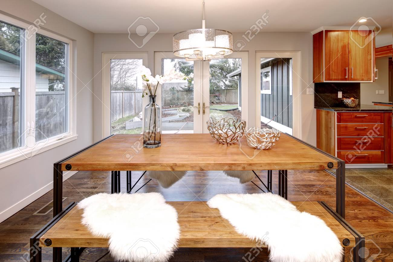 Spacious Dining Room With Wooden Table And French Doors To The Back Yard Standard