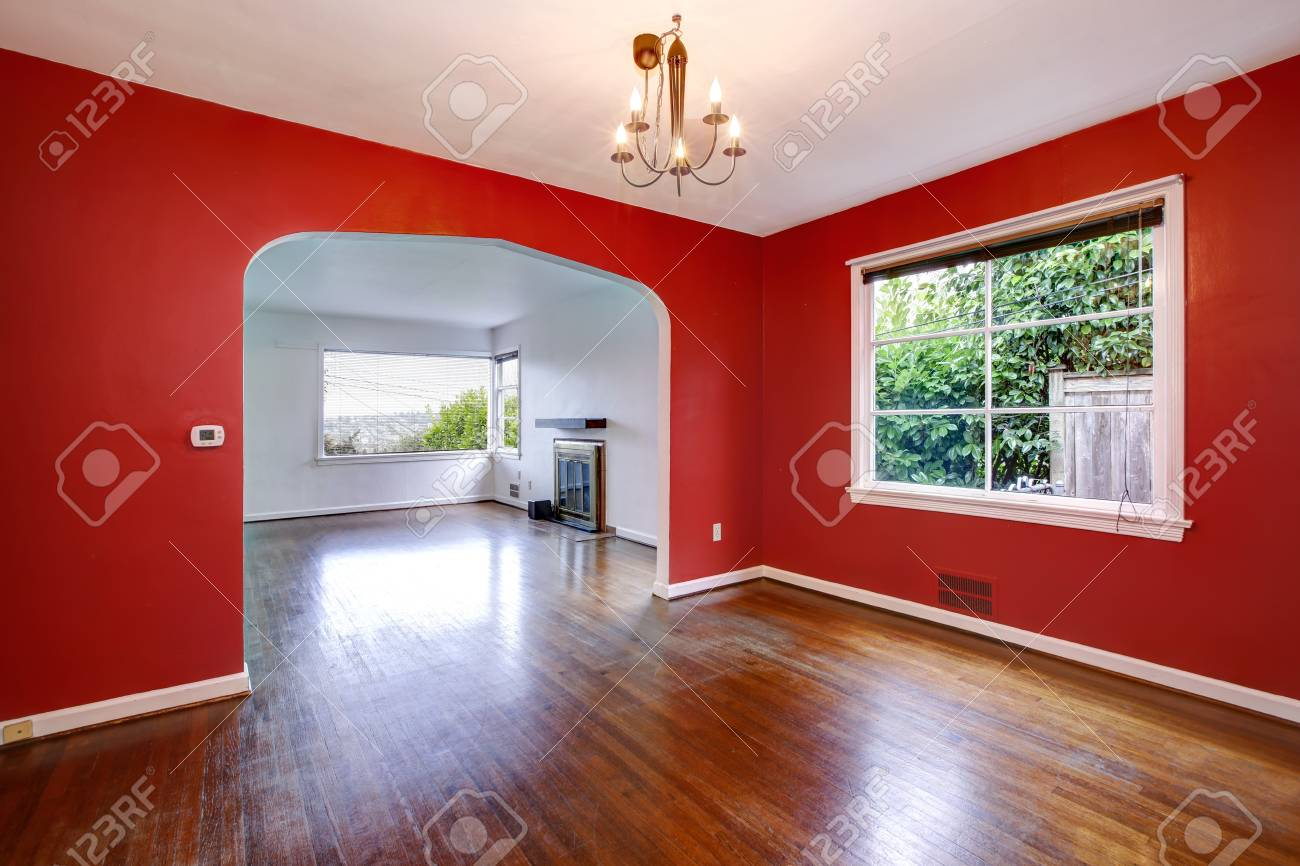 Transitional dining room with red walls in a craftsman style..