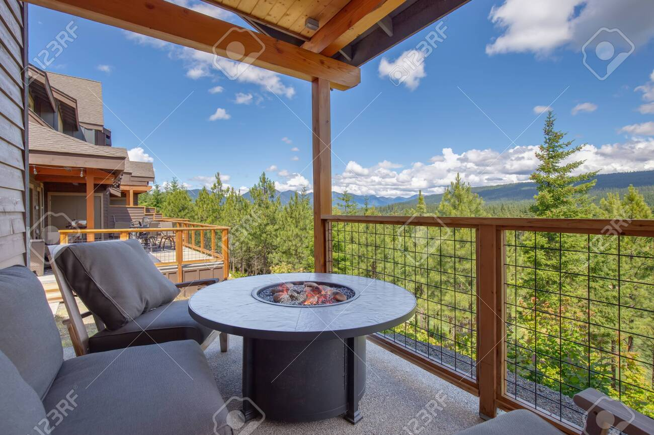 Amazing Balcony Patio With Fire Pit And Forest And Mountains Stock Photo Picture And Royalty Free Image Image 142643334