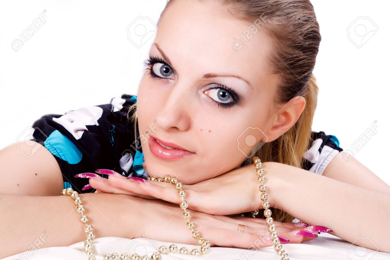 The dreaming woman yellow pearl necklace on the bared shoulders Stock Photo - 17414872