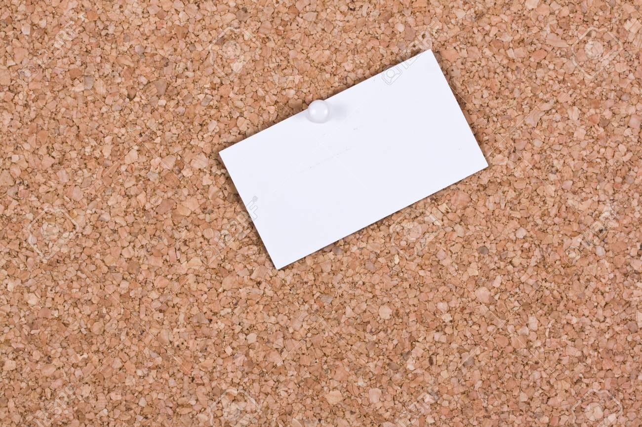 White blank business card attached to a cork board stock photo stock photo white blank business card attached to a cork board colourmoves