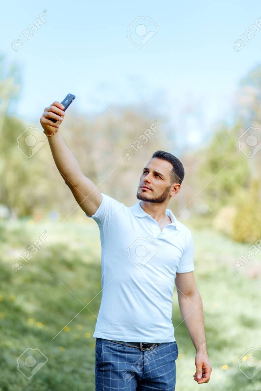 Cute Guy Takes A Selfie On The Phone In The Sun Stock Photo Picture And Royalty Free Image Image 123238405