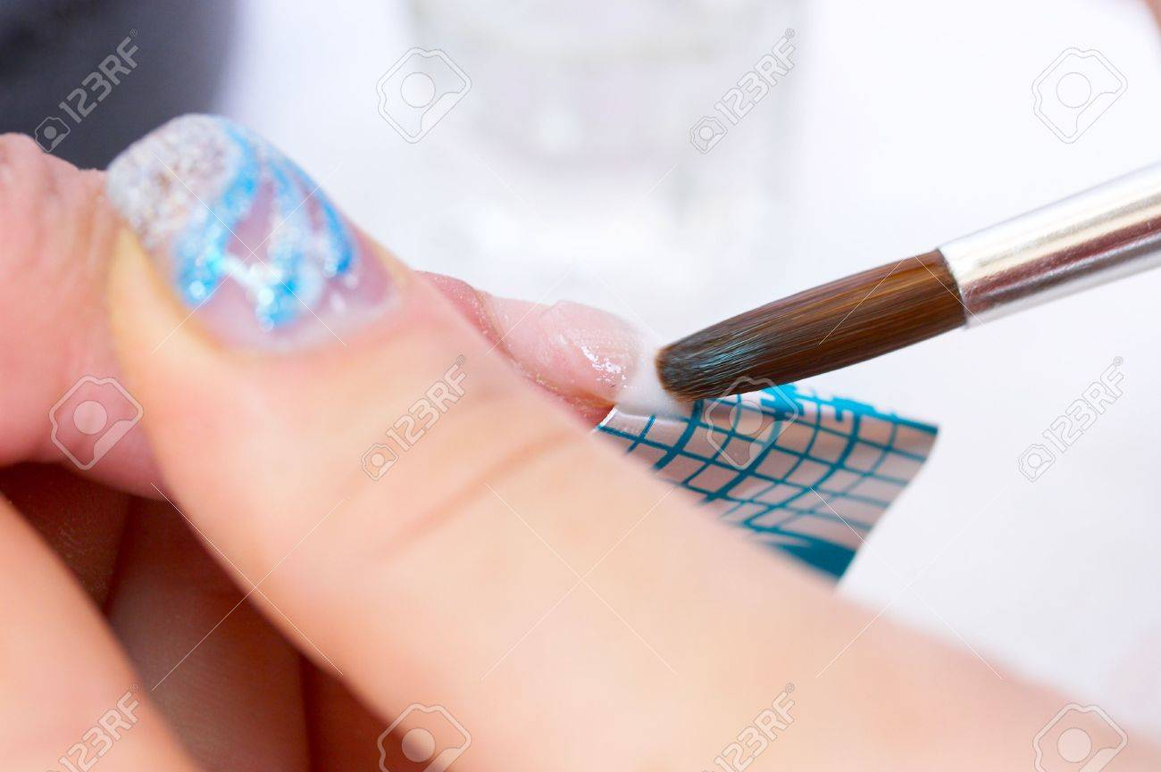 Correction Nails Using Acrylic And Disposable Form. Drawing.. Stock ...