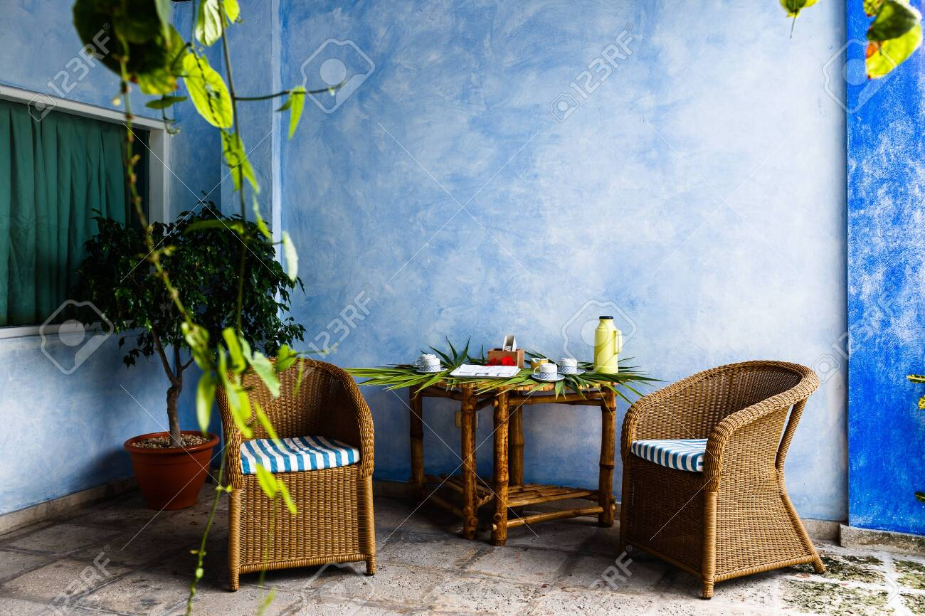 Two Rattan Chairs With Stripped Blue And White Cushions Standing Stock Photo Picture And Royalty Free Image Image 135912198
