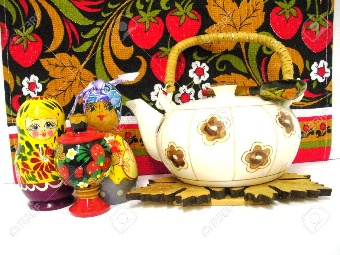 Tea-pot with Russian nesting dolls and samovar Stock Photo - 5994367
