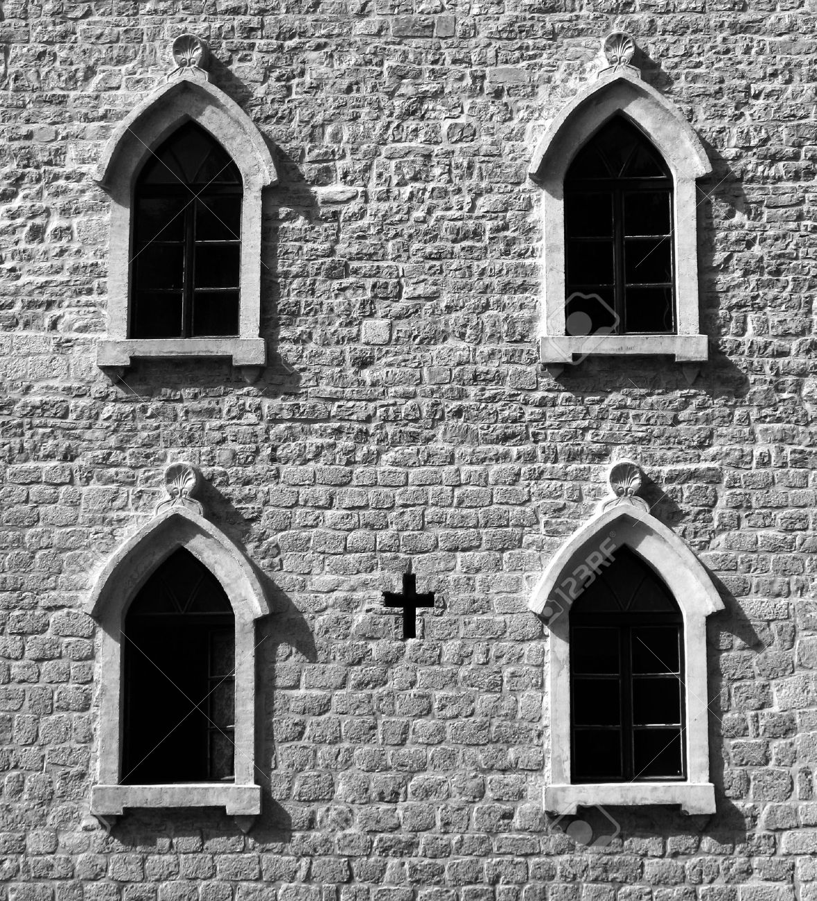 Brick Wall With Gothic Windows And Cross BW Image Stock Photo
