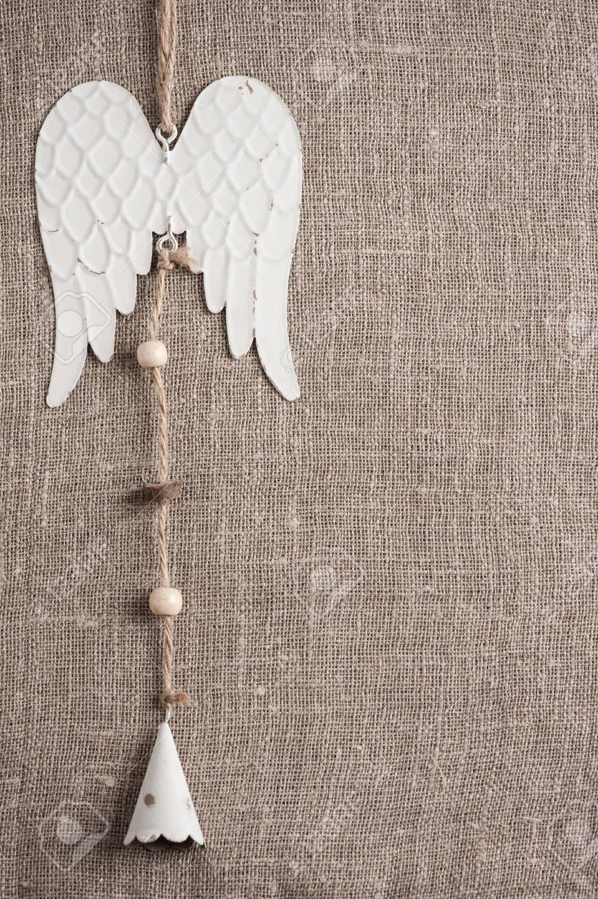 Linen Background With Christmas Decoration Angel Wings Toy