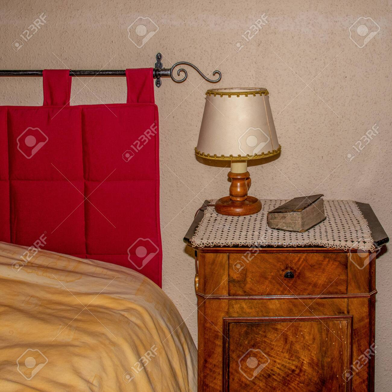 Victorian Decorated Bed And Side Table With Lamp And Bible