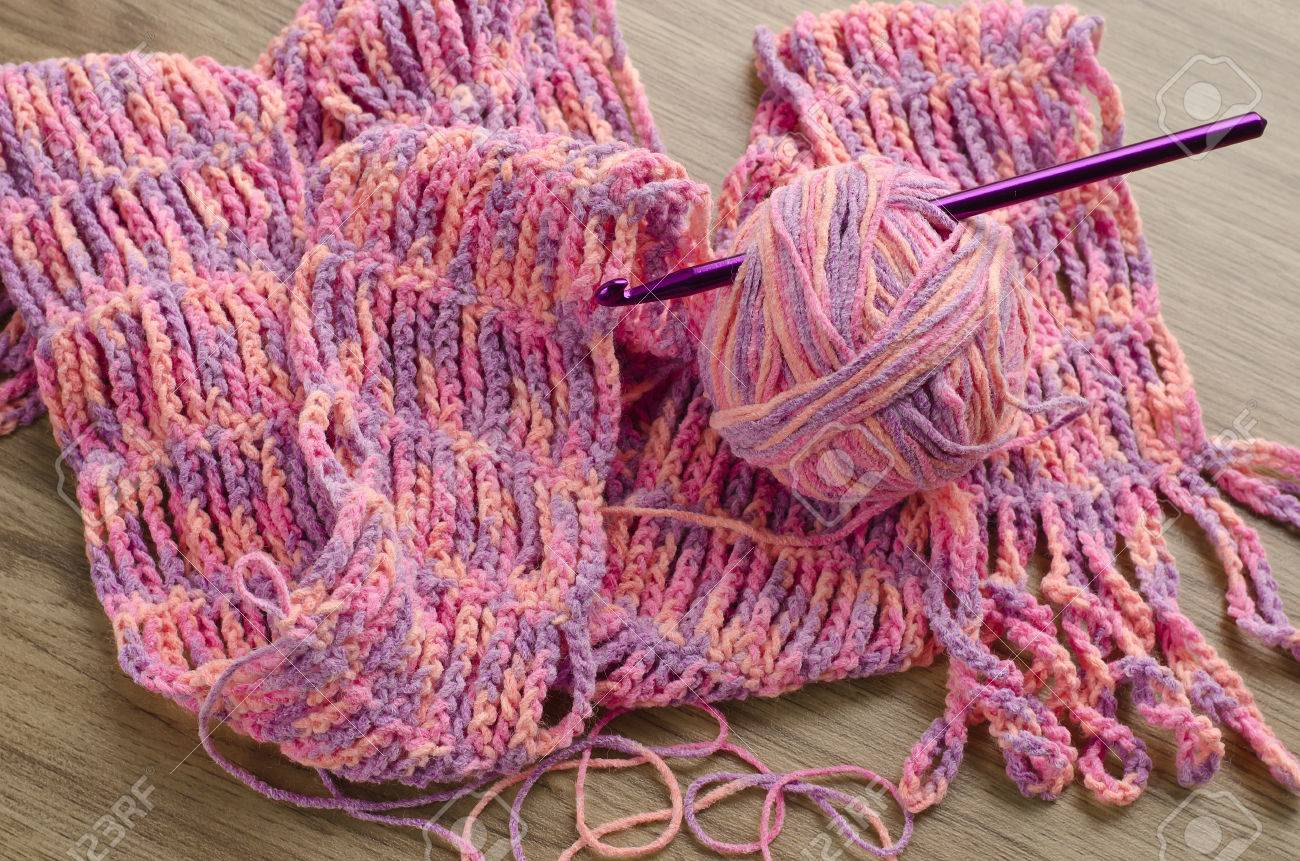 Multicolored Crochet Pattern With Yarn And Hook Stock Photo