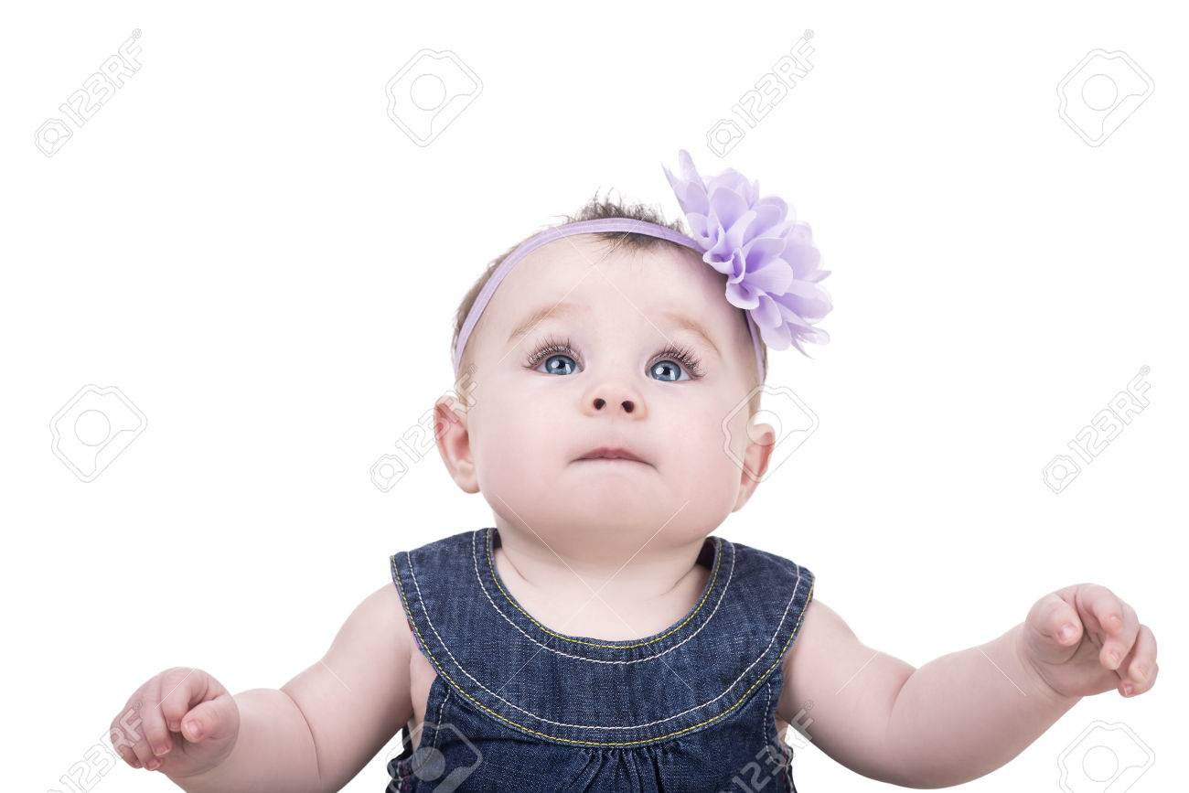 cute baby girl with big blue eyes and long eyelashes. portrait