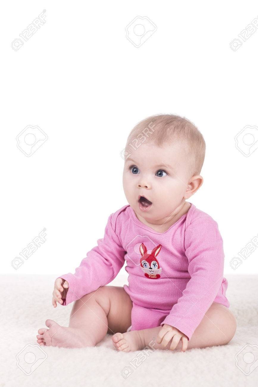 54fed4780d40 Cute Little Baby In Pink Bodysuit Sitting On A Blanket And Looking ...