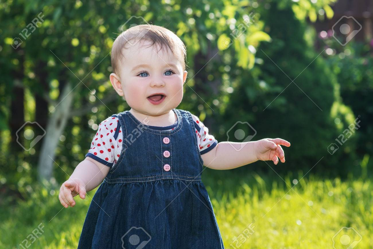 happy cute baby girl laughing and having fun on the nature, outdoor