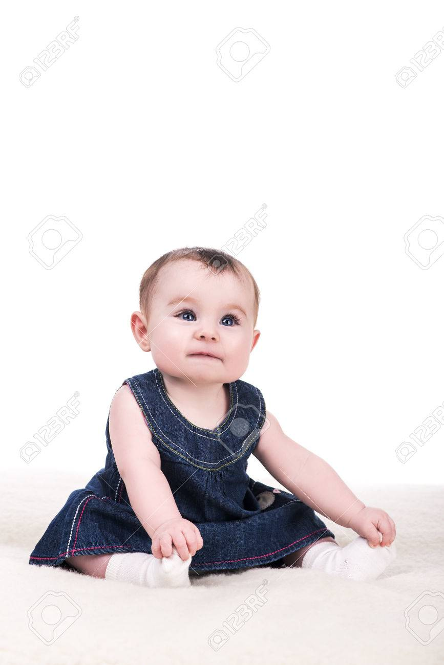 cute baby girl with big blue eyes and long eyelashes, isolated