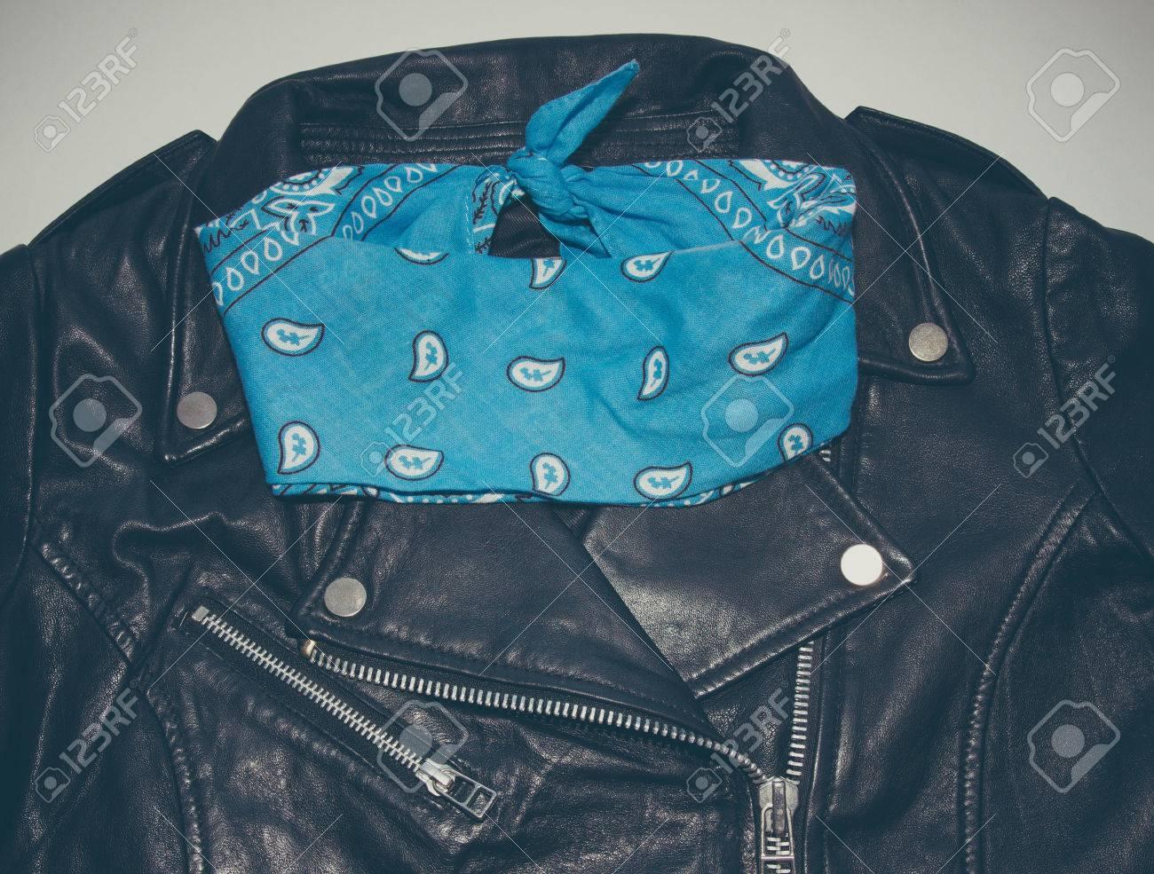 biker black leather jacket and blue folded bandana  Photo with