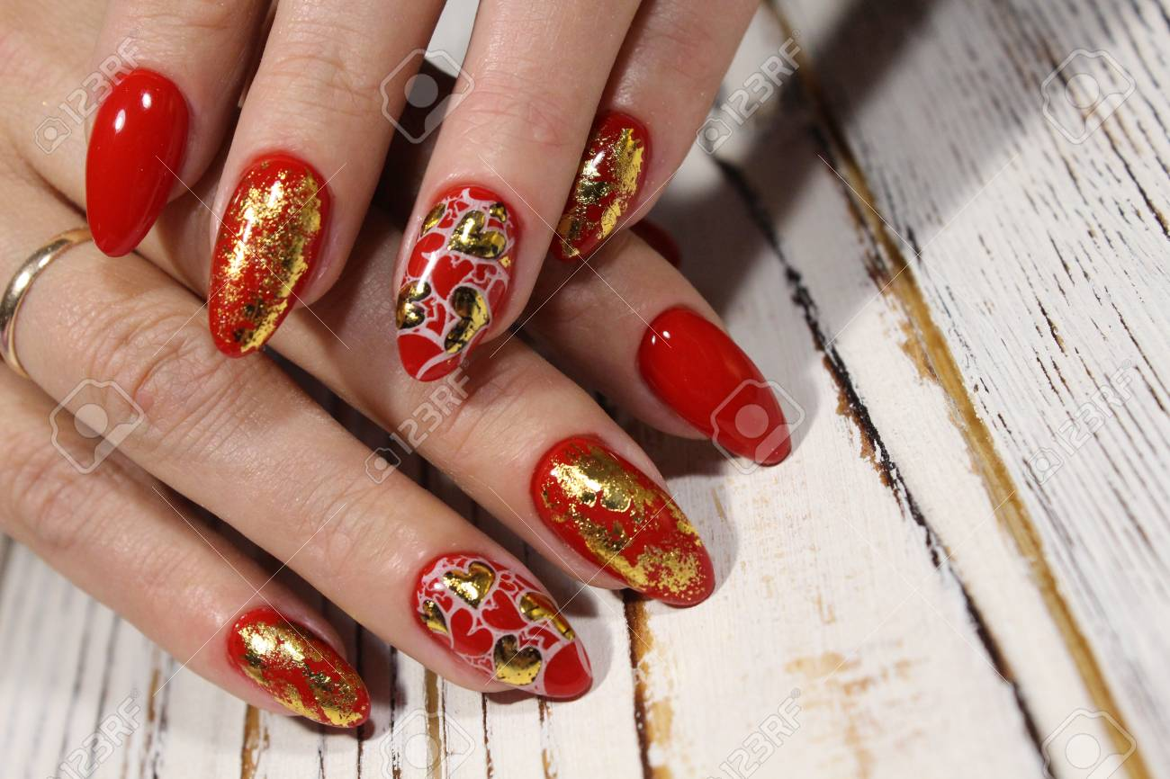 Beautiful Red Manicure On Long Nails With A Pattern Stock Photo ...
