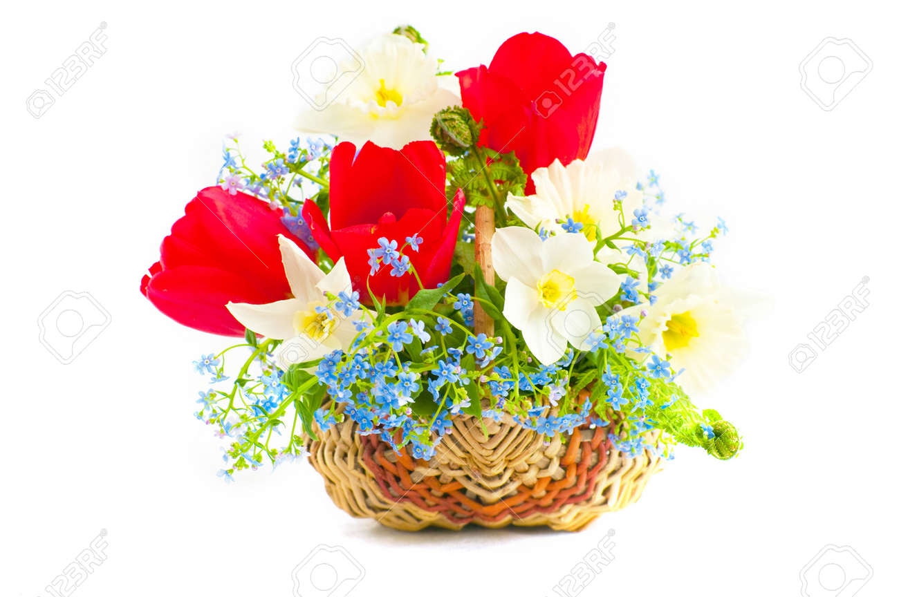 The Image Of A Bouquet Of Spring Flowers In A Wattled Basket Stock