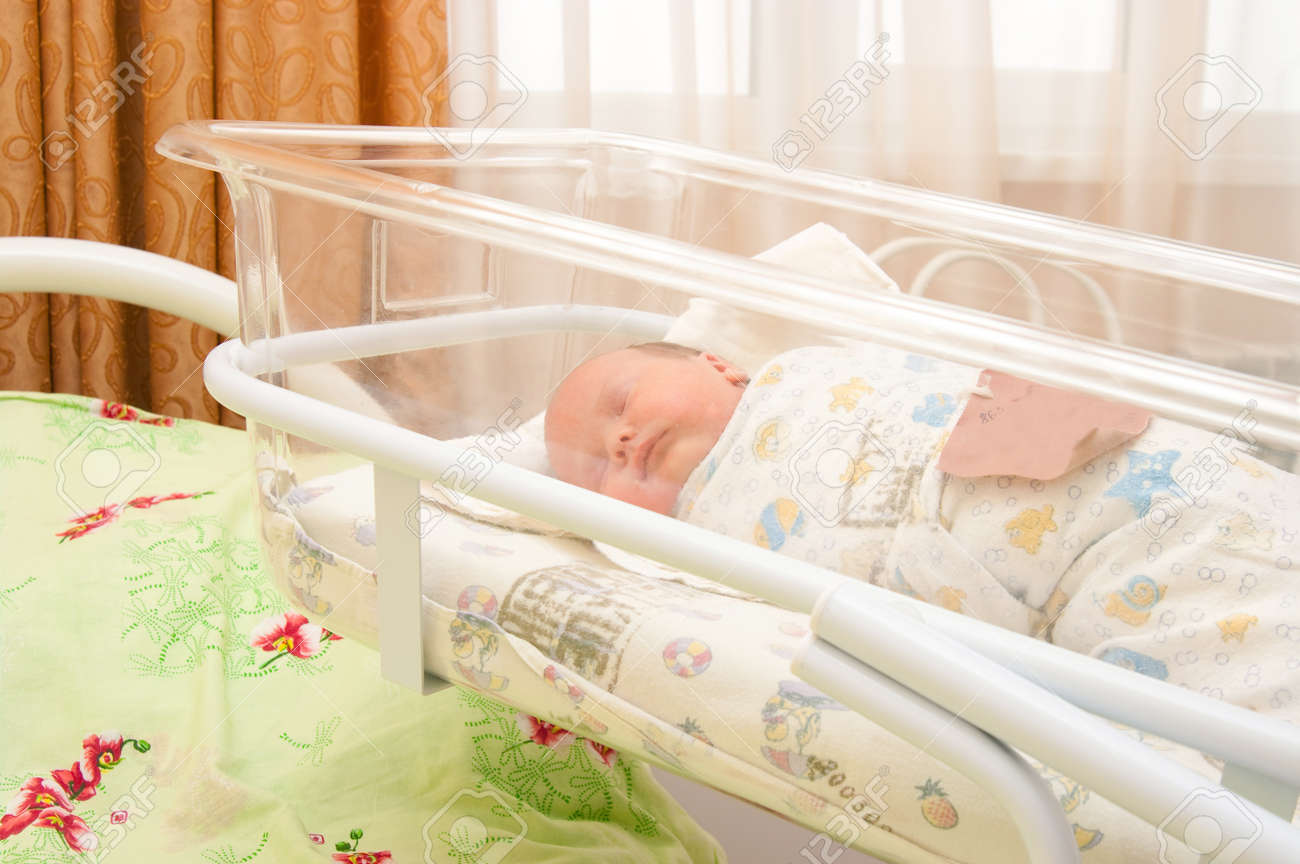 The image of the newborn lying in medical a bed Stock Photo - 8400993