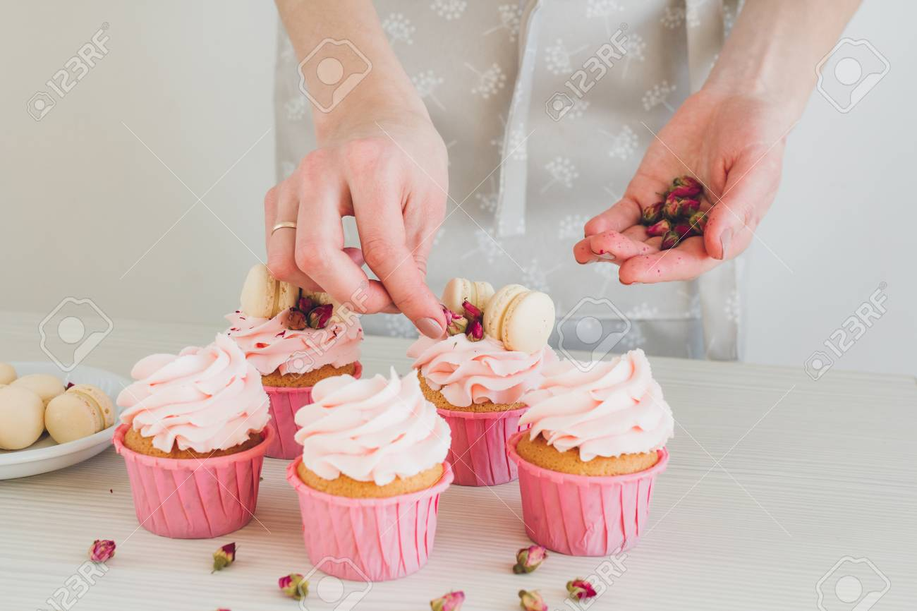 Young Girl Prepares Cupcakes Decorating The Concept Of Home Cooking Selective Focus