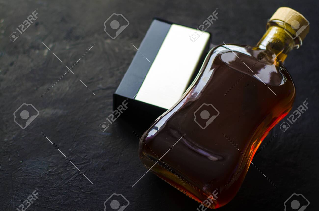 Male Cologne Male Cologne On A Black Background A Bottle Of Stock Photo Picture And Royalty Free Image Image 126051987