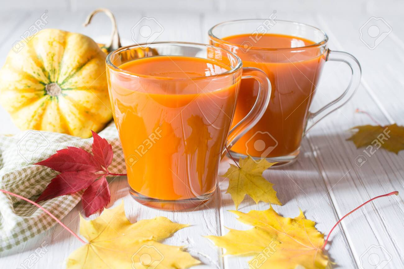 Fresh pumpkin juice or smoothie. Fall drink concept. On white background - 129267449