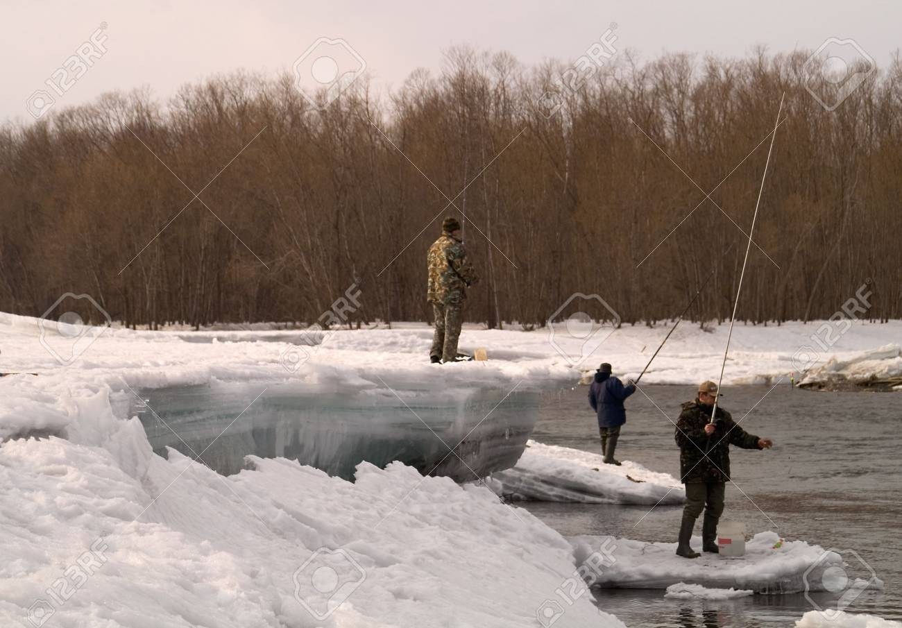 Fishermen go fishing on river during high water by springtime. Stock Photo - 2366792