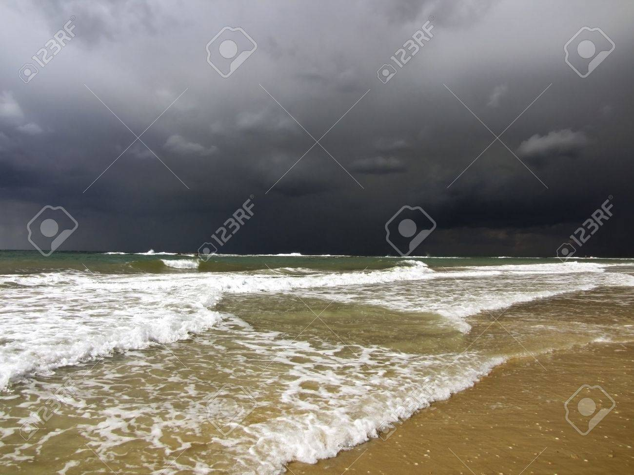 black storm clouds over the Mediterranean Sea and the waves incident on the beach Stock Photo - 12179749
