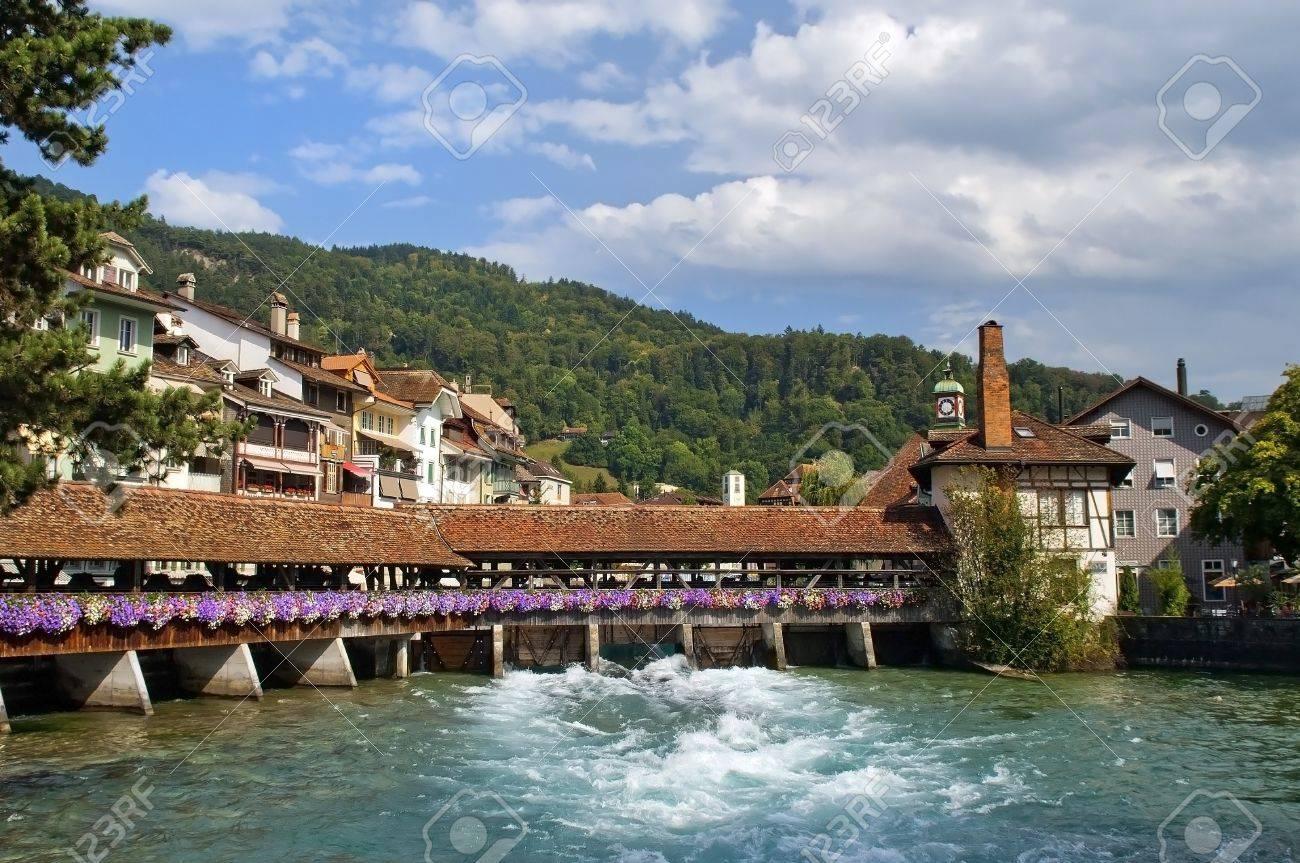 Famous old, wooden sluice bridge in Thun, Switzerland  Aare river Stock Photo - 12931098