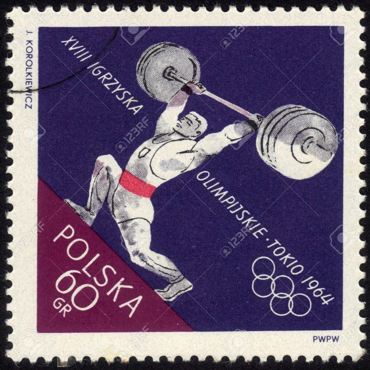 POLAND - CIRCA 1964: a stamp printed by POLAND shows the athlete raises a barbell., Series, circa 1964 Stock Photo - 13601945