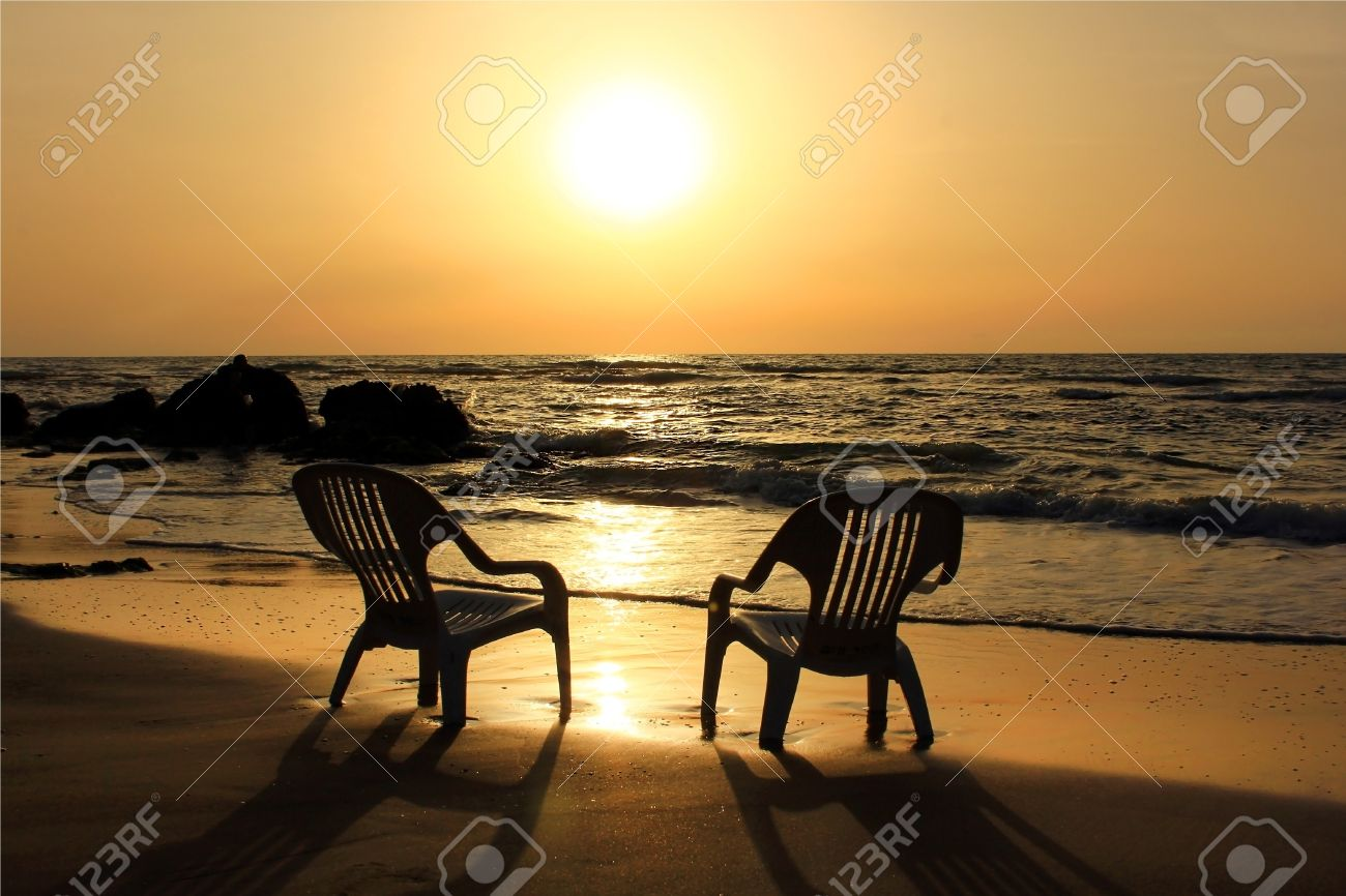 Beach sunset with chairs - Two Empty Chairs On The Beach Waiting For Lovers That Would Carry Out The Sunset