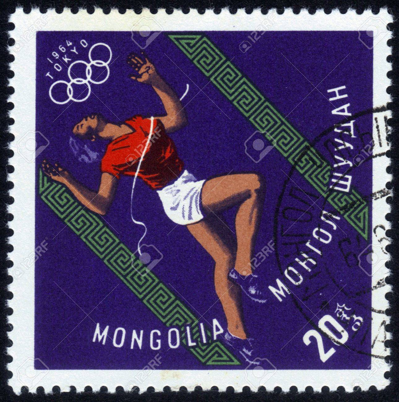 Mongolia - CIRCA 1964: a stamp printed by Mongolia shows an athlete runner, devoted to summer Olympic Games in Tokyo in 1964, series, circa 1964 Stock Photo - 14147236