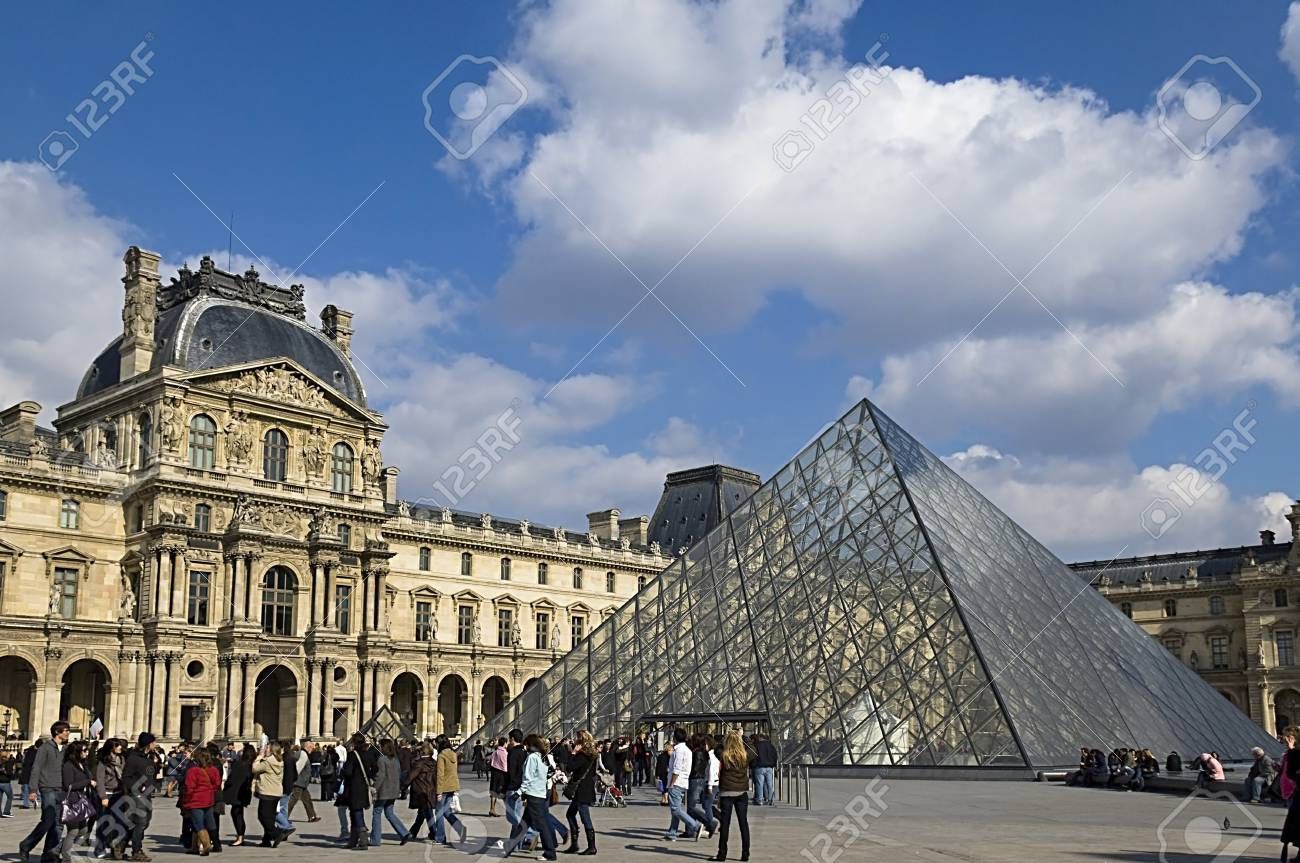 PARIS - March 15, 2010. Glass Pyramid at the Louvre Museum . The museum was inaugurated in 1739. Stock Photo - 14146696