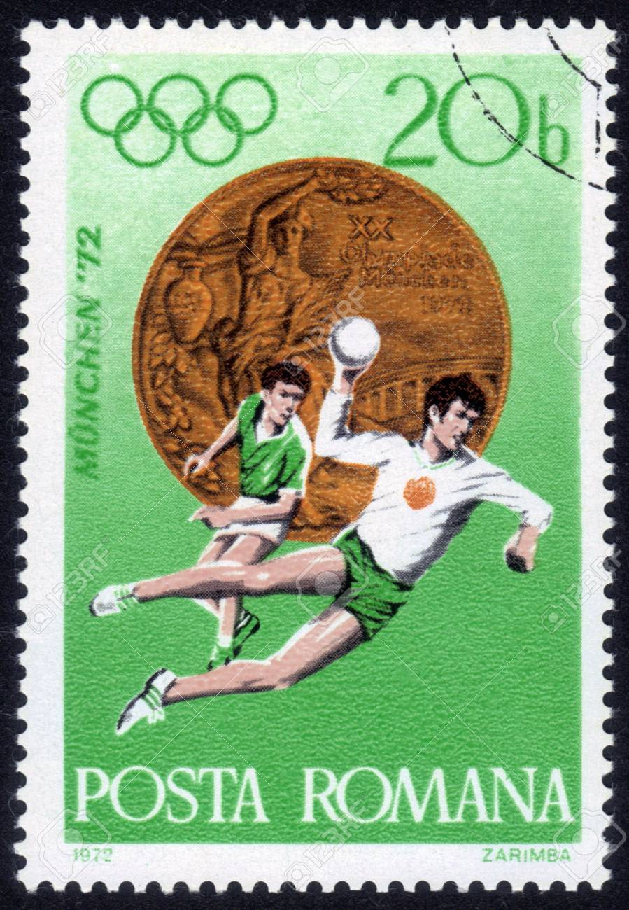 Romania - CIRCA 1972: a stamp printed by Romania, shows the players in handball. Summer Olympic Games in Munich, Germany in 1972, series, circa 1972 Stock Photo - 14242385
