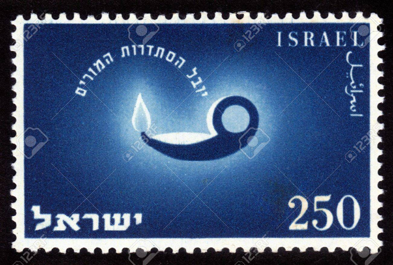 ISRAEL - CIRCA 1955  A stamp printed in the Israel shows image of the old oil lamps, issued in honor of 50th anniversary of the Teacher s Association, circa 1955 Stock Photo - 14376596