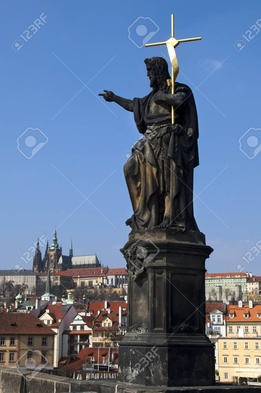Statue on Charles Bridge on the background of the Prague Castle , Prague , Czech republic Stock Photo - 14459455