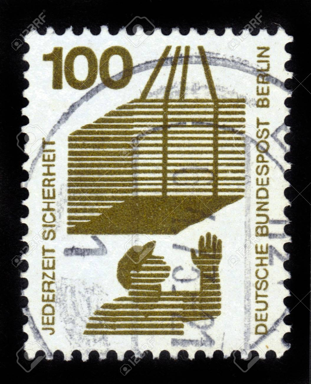 GERMANY - CIRCA 1973  a stamp printed in the Germany shows Hoisted Cargo, Accident Prevention, circa 1973 Stock Photo - 14720173