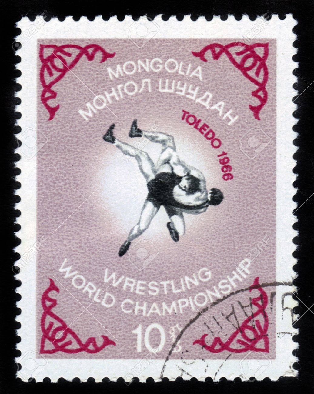 MONGOLIA - CIRCA 1966  a stamp printed in MONGOLIA shows two wrestlers with the inscription and name of series  Wrestling World Championship in Toledo , circa 1966 Stock Photo - 14794672