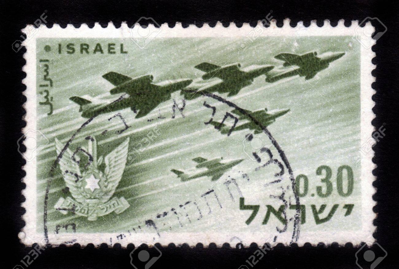 ISRAEL - CIRCA 1962  A stamp printed in Israel, shows a Israeli aircraft - bombers and military emblem - Israel s air force, Israel, series, circa 1962 Stock Photo - 14794658