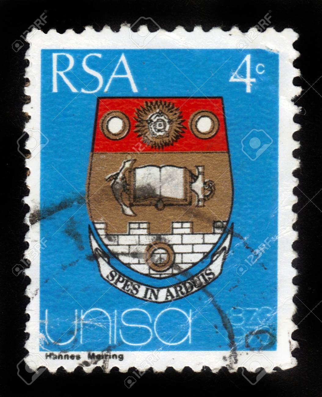 REPUBLIC OF SOUTH AFRICA - CIRCA 1973: A stamp printed in Republic of South Africa shows coat of arms of the university of the South Africa (Unisa), dedicated to the centenary, circa 1973 Stock Photo - 15004713