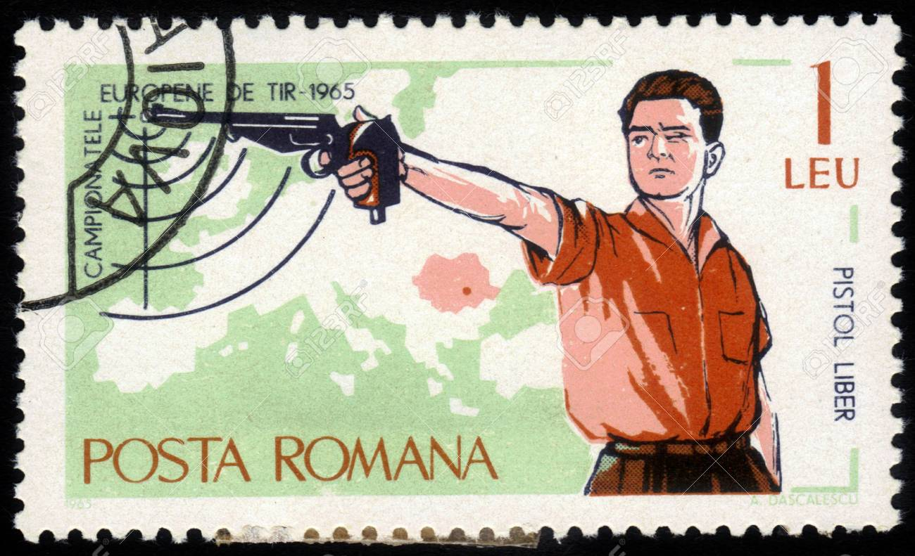 ROMANIA - CIRCA 1965: A stamp printed in the Romania, dedicated to the European Championship by shooting in Bucharest, shows a sportsman shooting a pistol, circa 1965 Stock Photo - 15319498