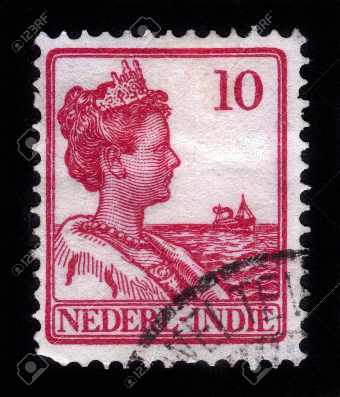 NETHERLANDS INDIES - CIRCA 1912: A stamp printed in the Netherlands Indies shows Queen Wilhelmina of the Netherlands (1880-1962), circa 1912 Stock Photo - 15485074