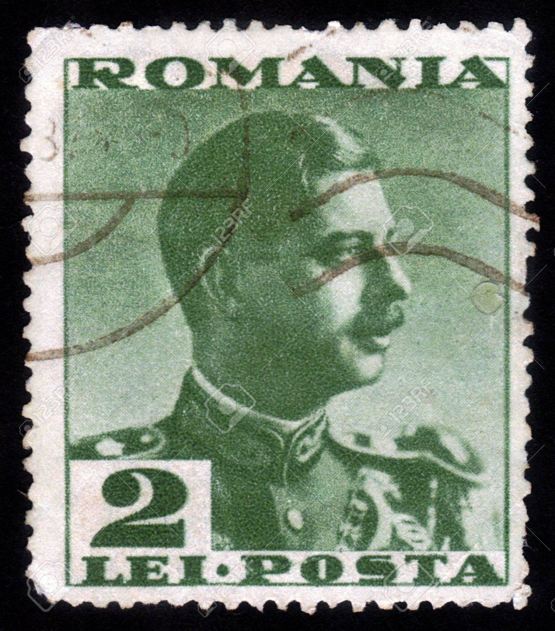 ROMANIA - CIRCA 1935: A stamp printed in the Romania, shows portrait of the King of Romania Carol II on a green background, circa 1935 Stock Photo - 15485079