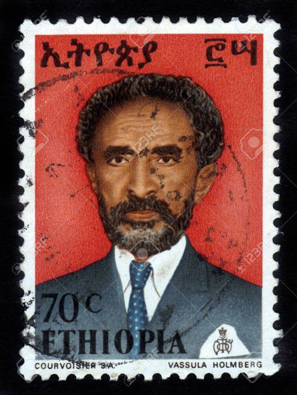 ETHIOPIA - CIRCA 1958 : A stamp printed in Ethiopia shows image of  emperor Haile Selassie on a red background , with the inscription in Amharic , series, circa 1958 Stock Photo - 15641720