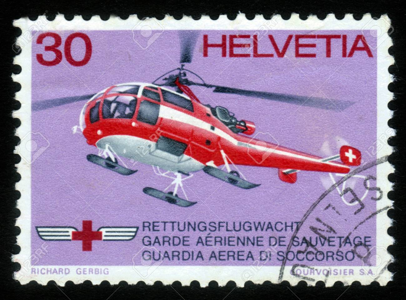 SWITZERLAND - CIRCA 1972: a stamp printed in the Switzerland shows Red Cross Rescue Helicopter, circa 1972 Stock Photo - 15641715