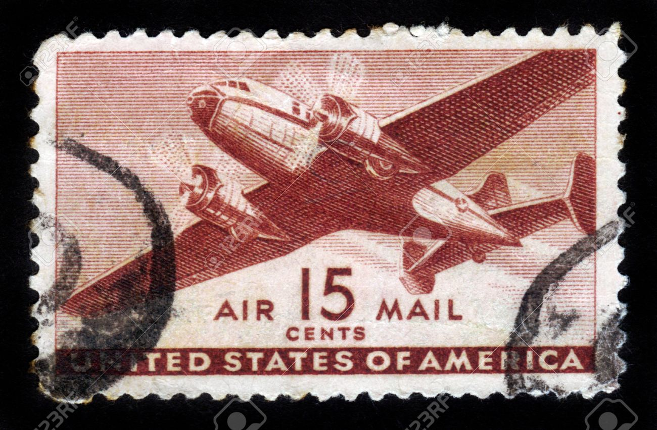 UNITED STATES OF AMERICA - CIRCA 1950s: A stamp printed in the USA shows two engine transport plane, circa 1950s Stock Photo - 16348366