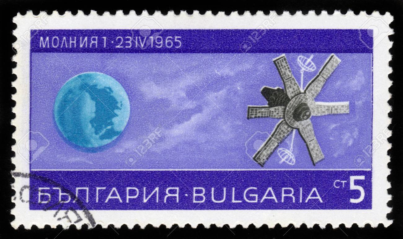 BULGARIA - CIRCA 1965  A stamp printed in Bulgaria shows Earth and Soviet satellite   molnia 1  , Lightning 1 , circa 1965 Stock Photo - 16878673