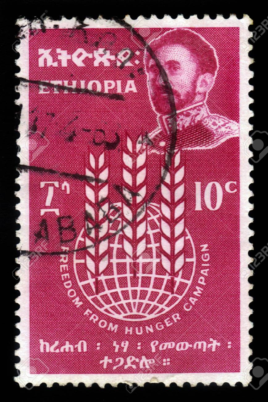 ETHIOPIA - CIRCA 1963   A stamp printed in Ethiopia shows image of  emperor Haile Selassie on a red background , with the inscription   freedom from hunger campaign, circa 1963 Stock Photo - 17990265
