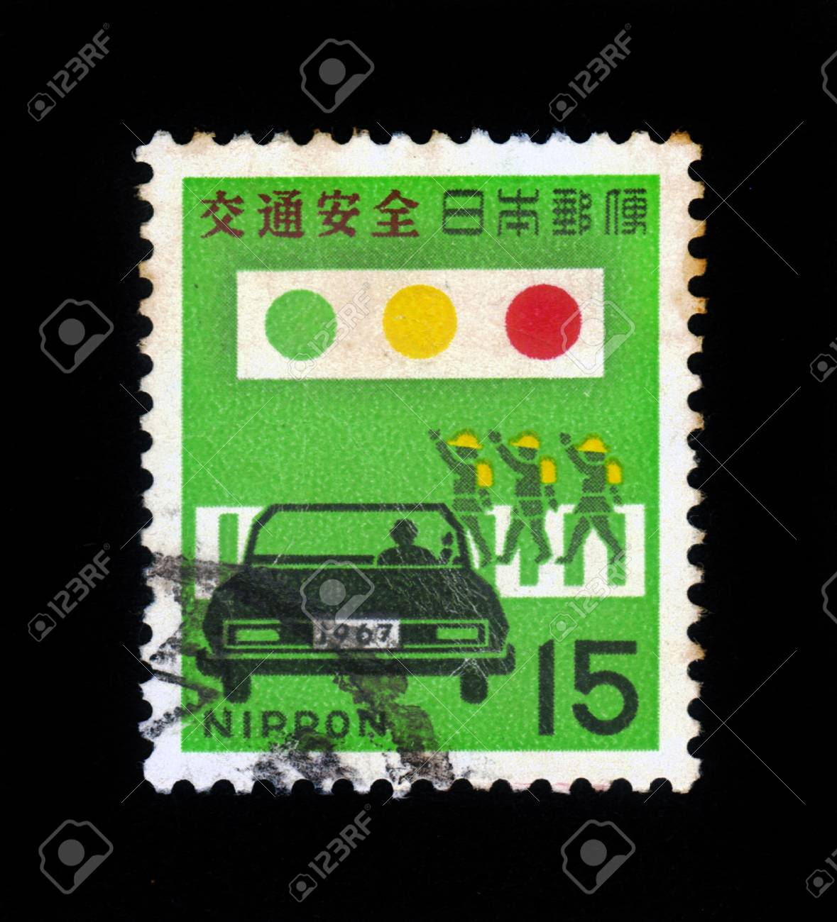 JAPAN - CIRCA 1967  A stamp printed in japan shows symbolic image of car, traffic light and people on a pedestrian crossing, road safety, circa 1967 Stock Photo - 19598745