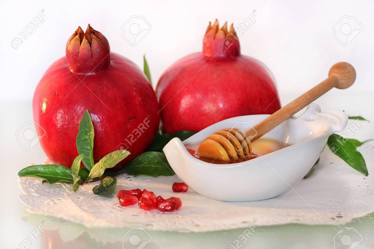 Symbols of holiday of rosh hashanah traditional jewish food symbols of holiday of rosh hashanah traditional jewish food honey and pomegranate stock photo biocorpaavc